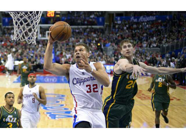 Los Angeles Clippers forward Blake Griffin, center, puts up a shot on Saturday in Los Angeles.