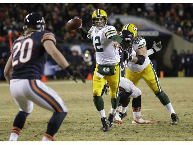Green Bay clinched the NFC North crown with a win over Chicago on Sunday.