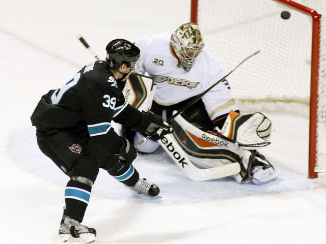 San Jose Shark Logan Couture, left, scores a goal past Anaheim Ducks goalie Frederik Andersen on Sunday.