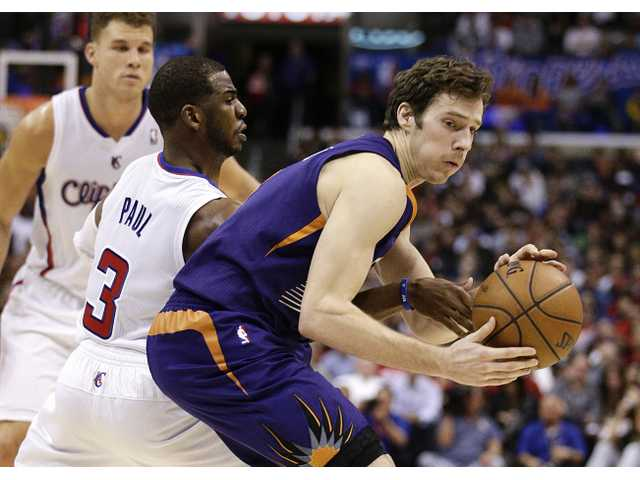 Phoenix Sun Goran Dragic (right) is defended by Los Angeles Clipper Chris Paul on Monday night in Los Angeles.