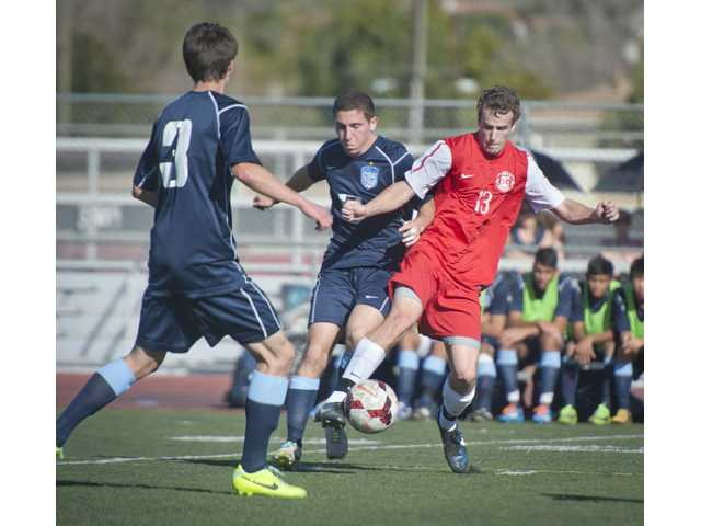 Hart midfielder Tad Hawthorne fights for possession of the ball against a Crescenta Valley defender at Hart High on Monday.