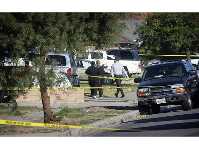 Fontana police crime scene investigators arrive at a home on Tuesday, where a family of four was found shot to death just before 10 p.m. Monday in Fontana.