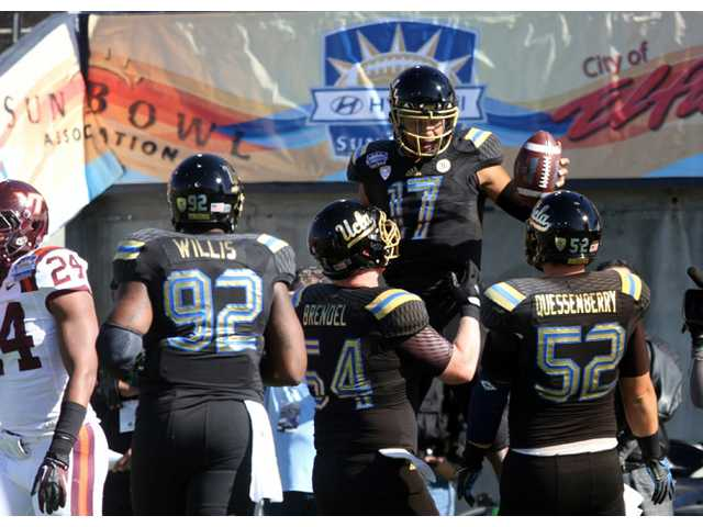 UCLA quarterback Brett Hundley (17) celebrates with teammates against Virginia Tech in the Sun Bowl on Tuesday in El Paso, Texas.