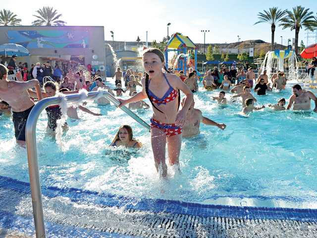 Eva Jackson, 12, of Canyon Country, exits the 44 degree water of the pool and heads for the waterside to start out the new year during Wednesday's Arctic Chill Polar Bear Swim at the Santa Clarita Aquatic Center. Photo by Jayne Kamin-Oncea for The Signal.