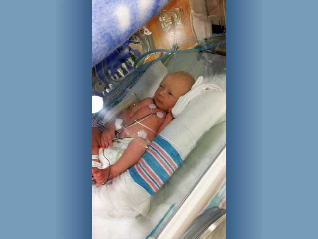 This photo provided by the Garrisons shows newborn Benjamin Martin Garrison in the Neonatal Intensive Care Unit at Henry Mayo Newhall Memorial Hospital.  Banjamin was born just one minute after his twin sister, Ruby Isabelle Garrison, who became the first local baby born in 2014.