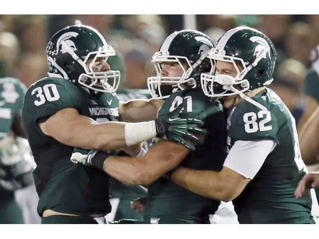 Spartans ride defense to Rose Bowl win