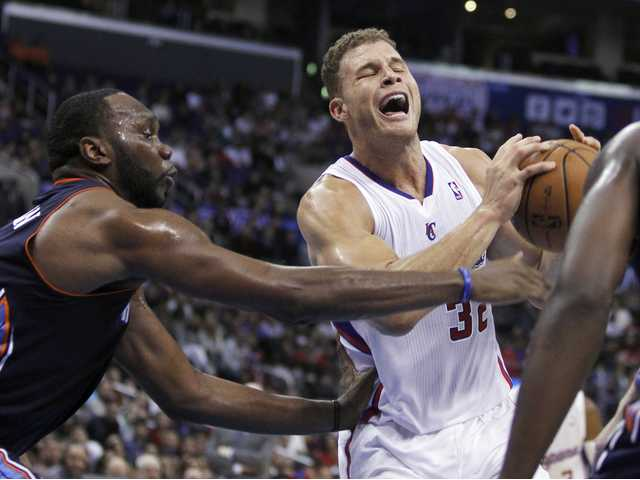 Los Angeles Clippers forward Blake Griffin, right, pulls up to shoot as Charlotte Bobcats center Al Jefferson, left, defends. The Clippers won 112-85.