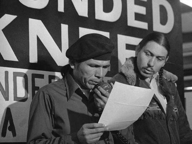 Carter Camp, right, in 1973, a longtime activist with the American Indian Movement who was a leader in the Wounded Knee occupation in South Dakota, died Dec. 27 at age 72.