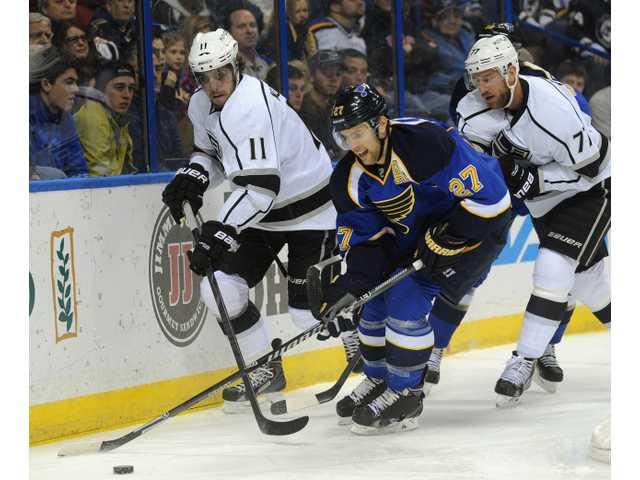 St. Louis Blue Alex Pietrangelo (27) gets the puck past Los Angeles Kings defenders on Thursday night.