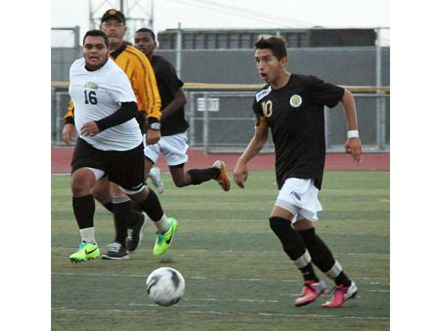 Golden Valley's Francisco Perez dribbles the ball as a Pete Knight defender pursues. The Grizzlies boys soccer team is 5-6-2 to begin the season.