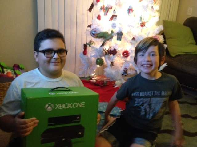 Santa Clarita residents came to a young mom's rescue to ensure her children had a visit from Santa. Above, Hayden, 12 (left), and Dylan, 9, showing off a present a local resident gave to Santa for delivery to the boys. Courtesy photo