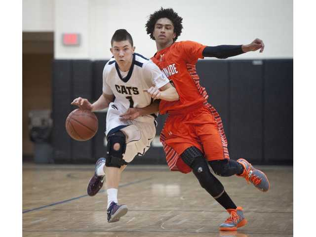 West Ranch point guard Ryan Beddeo runs past a Chaminade defender during Friday's game at West Ranch High.