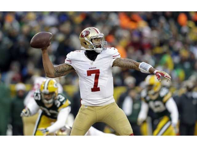 San Francisco 49ers quarterback Colin Kaepernick (7) throws a pass during the first half of Sunday's wild card game in Green Bay.