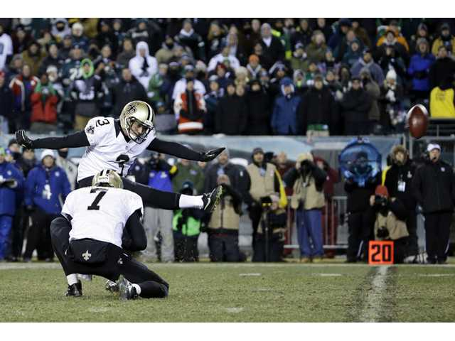New Orleans Saints' Shayne Graham kicks the game-winning field goal against the Philadelphia Eagles on Saturday in Philadelphia.