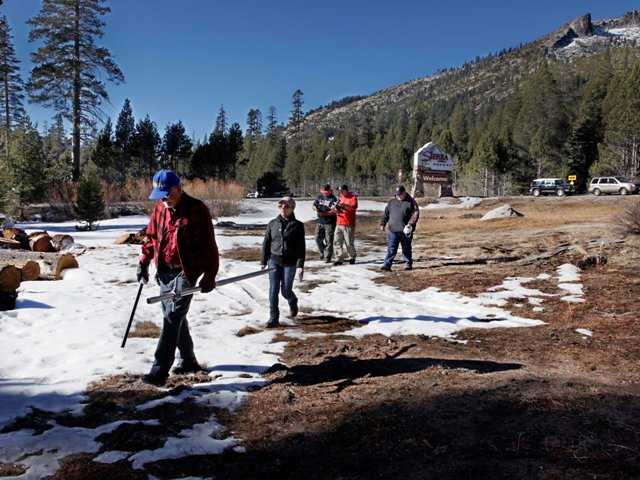 Frank Gehrke, chief of snow surveys for the California Department of Water Resources, left, leads his group out to measure snow levels near Echo Summit, Calif., on Friday. The Associated Press