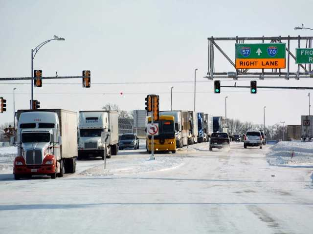 Six semis and about 375 vehicles to get stuck along a snowy stretch of interstate in southern Illinois in what officials are calling the worst possible circumstances.