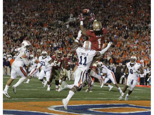 Florida State wide receiver Kelvin Benjamin catches the game-winning touchdown pass on Monday in Pasadena.