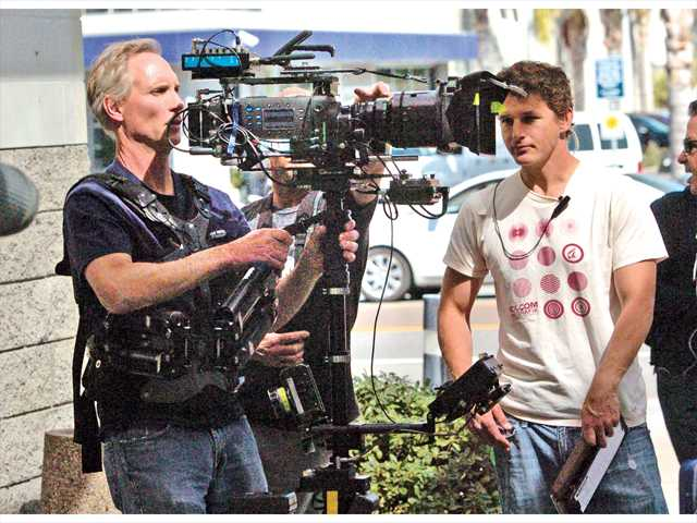 In this Signal file photo, camera operator Rob Carlson, left, and 2nd assistant James Troost prepare to shoot a scene for the CBS primetime drama NCIS. Filming activity in the Santa Clarita Valley has risen for a third straight year, generating an estimated $30.5 million in 2013.