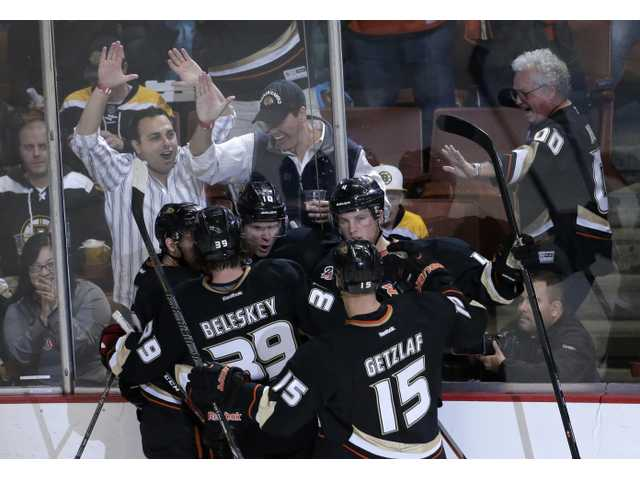 Fans and members of the Anaheim Ducks celebrate Corey Perry's goal on Tuesday in Anaheim.