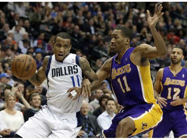 Dallas Mavericks guard Monta Ellis (left) attempts to drive past Laker Wesley Johnson on Tuesday in Dallas.