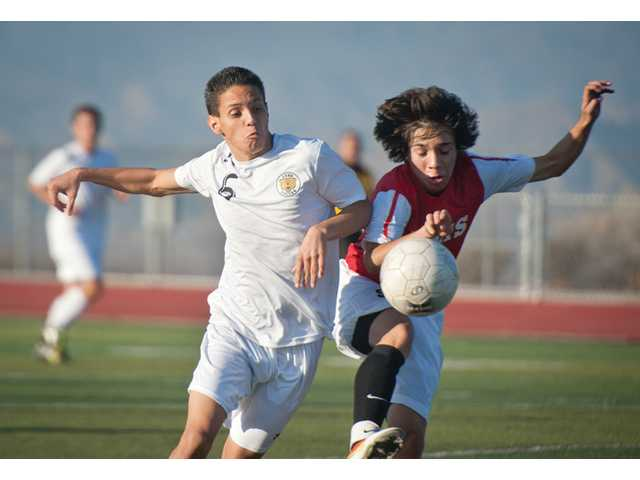 Golden Valley's Romulo Hurtado, left, fights for possession of the ball against Santa Paula on Wednesday at Golden Valley.