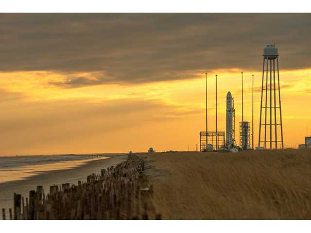 An Orbital Sciences Corp. Antares rocket sits on a launch pad before its launch from NASA's Wallops Flight Facility in Wallops Island, Va. on Monday.