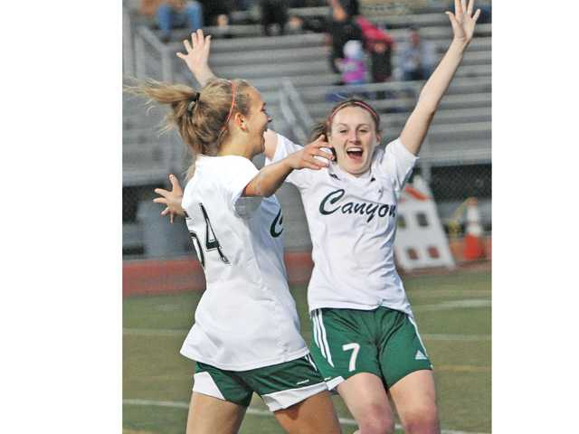 Canyon players Sarah Cipperley, left, and Brooke Moore celebrate after Cipperley's goal at Canyon on Thursday.