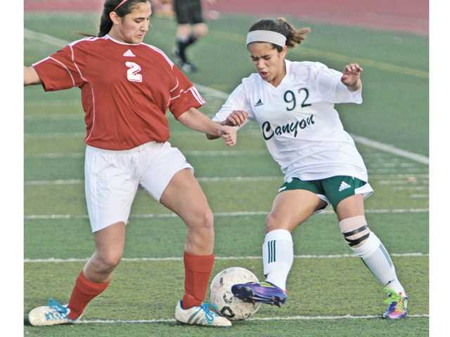 Canyon's Vanessa Quintero (92) , right, dribbles past Emily Moreno (2) of Lancaster High School at Canyon High on Thursday at Canyon.