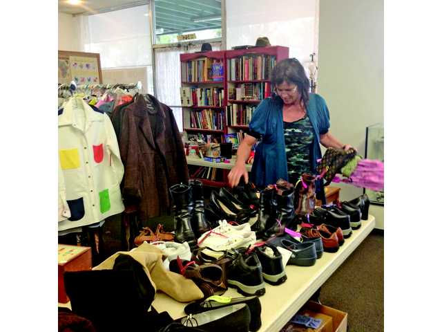 Assistant store manager Kathy Spears finds a place for every item donated to the thrift store at the Church of Hope in Canyon Country.