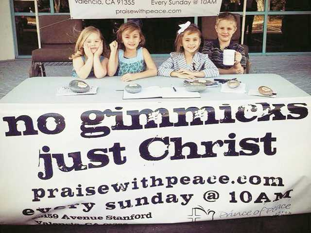 1: Children at the welcome table at the Prince of Peace Lutheran church's dedication ceremony. Crystal Boon/Courtesy photo