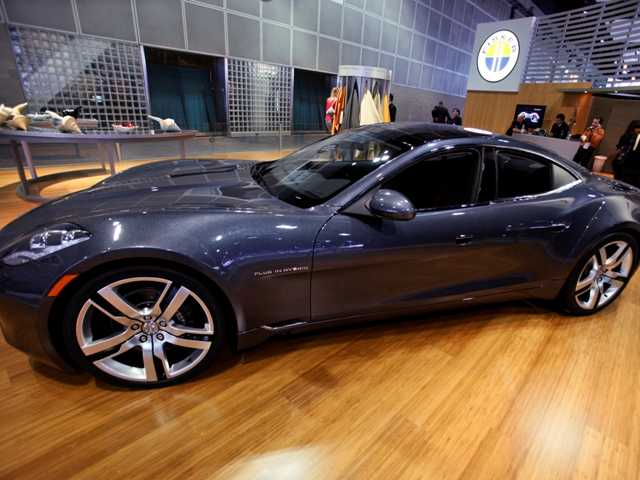 Fisker Automotive's Fisker Karma, a sports luxury plug-in hybrid car, shown at the 2010 Los Angeles Auto Show. The company is bankrupt and up for auction.