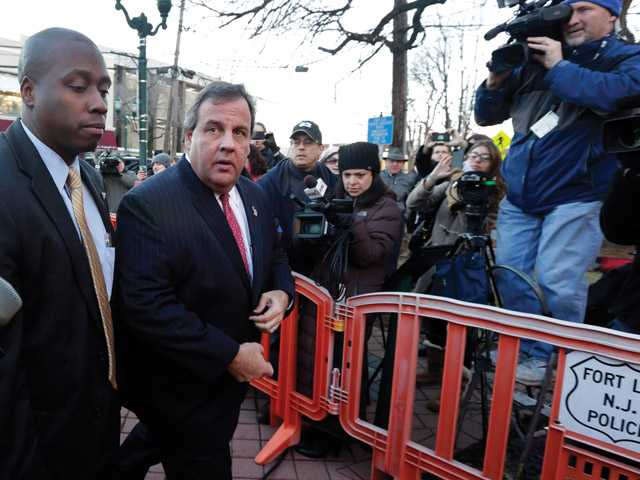 "New Jersey Gov. Chris Christie, second left, arrives at Fort Lee, N.J., City Hall, Thursday, Jan. 9, 2014. Christie traveled to Fort Lee to apologize in person to Mayor Mark Sokolich. Moving quickly to contain a widening political scandal, Gov. Chris Christie fired one of his top aides Thursday and apologized repeatedly for the ""abject stupidity"" of his staff, insisting he had no idea anyone around him had engineered traffic jams to get even with a Democratic mayor."
