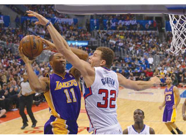 Los Angeles Lakers guard Wesley Johnson, left, puts up a shot as Los Angeles Clippers forward Blake Griffin defends on Friday in Los Angeles.