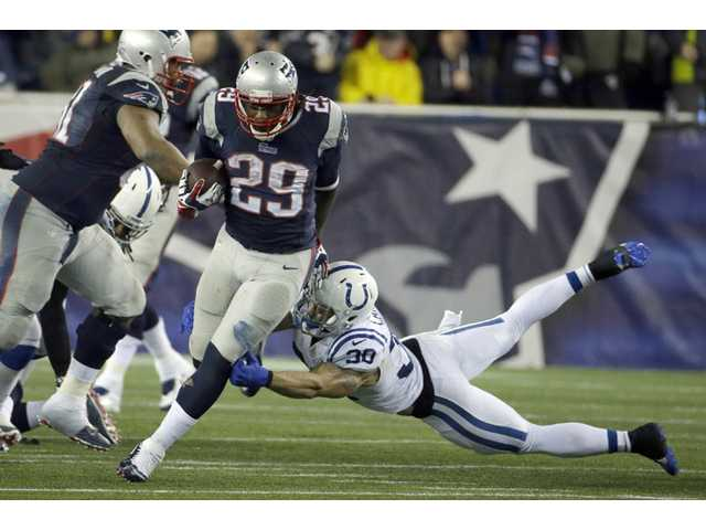 New England Patriots running back LeGarrette Blount (29) runs against the Indianapolis Colts in Foxborough, Mass. on Saturday.