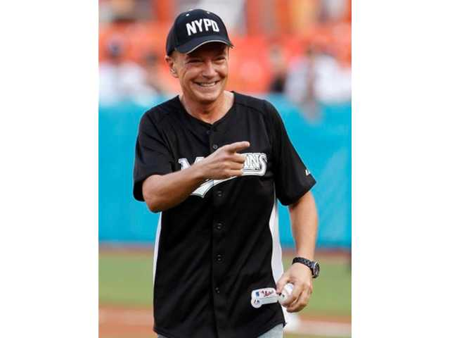 This July 9, 2011 file photo shows actor David Cassidy after throwing out a ceremonial first pitch before a baseball game between the Florida Marlins and the Houston Astros, in Miami. Cassidy was arrested Friday Jan. 10, 2014, in Southern California on suspicion of drunken driving.