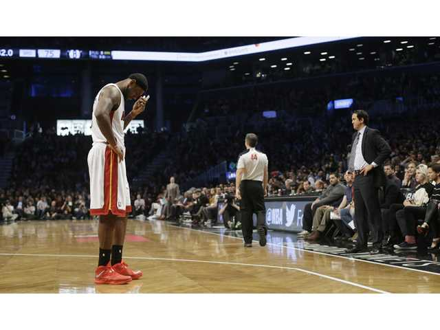 Miami Heat's LeBron James, left, and Miami Heat's head coach Erik Spoelstra, right, react on Friday in New York.