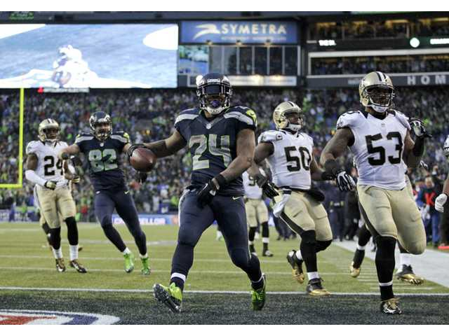 Seattle Seahawks running back Marshawn Lynch (24) arrives in the end zone against the New Orleans Saints in Seattle on Saturday.