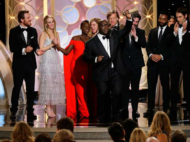 "This image released by NBC shows Steve McQueen, center, accepting the award for best motion picture drama for ""12 Years a Slave"" during the 71st annual Golden Globe Awards at the Beverly Hilton Hotel on Sunday."