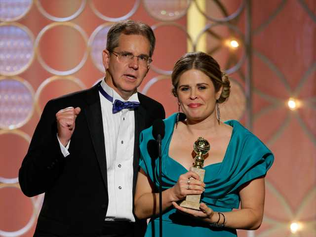 "This image released by NBC shows Chris Buck, left, and Jennifer Lee accepting the award for best animated feature for ""Frozen"" during the 71st annual Golden Globe Awards at the Beverly Hilton Hotel on Sunday."