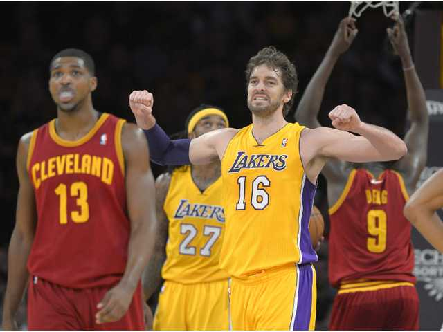Los Angeles Lakers center Pau Gasol (16) grimaces after the Lakers turned over the ball on Tuesday night in Los Angeles.