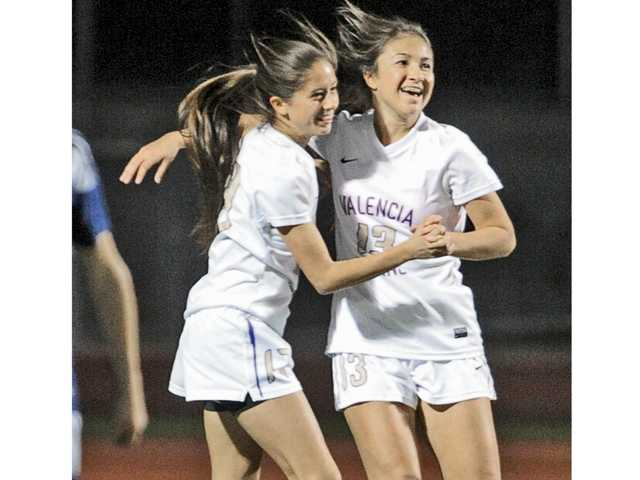 Valencia players Alexa Thornblad, left, and Sara Silvestro (13) celebrate after Valencia's first goal against Saugus at Valencia on Tuesday.