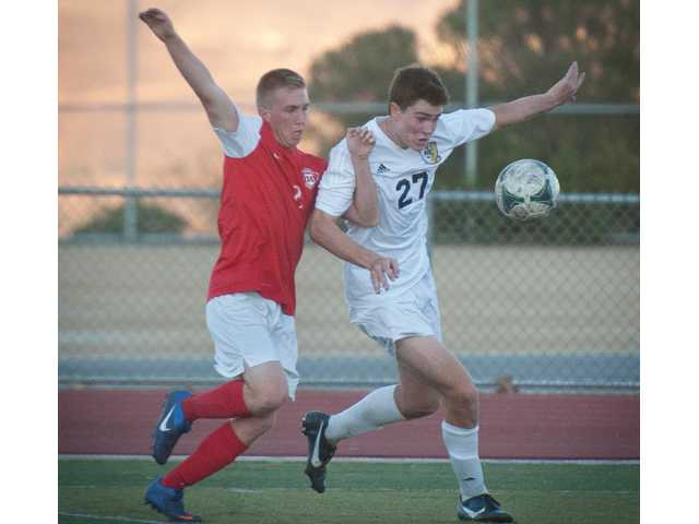 West Ranch's Rhys Weatley, right, battles Hart's Riley Waldeck, left, for the ball during Tuesday's game at West Ranch.