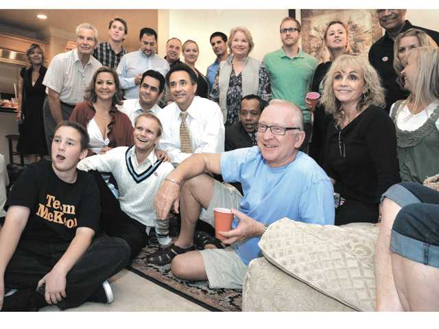 "Howard ""Buck"" McKeon and wife, Patricia, behind him, watch election returns in their Valencia home with friends and family in 2012. Signal file photo"
