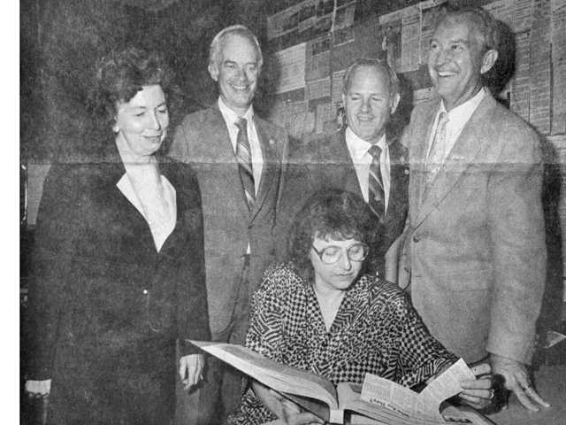 "This 1987 Signal file photo shows the first Santa Clarita City Council reviewing a scrapbook of events leading to city formation. Standing from left are Jo Anne Darcy, Carl Boyer, Dennis Koontz and Howard ""Buck"" Mckeon. Seated with the book is Jan Heidt."