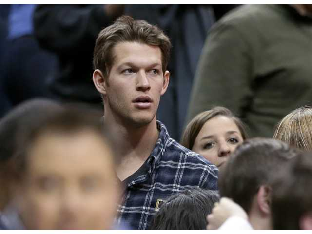Los Angeles Dodgers pitcher Clayton Kershaw watches an NBA game between the Lakers and Mavericks on Jan. 7 in Dallas.