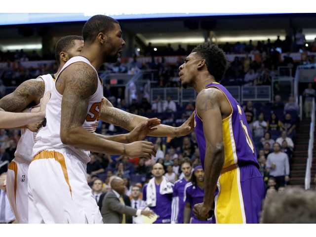Los Angeles Laker Nick Young, right, has a heated conversation with Phoenix players on Wednesday in Phoenix.