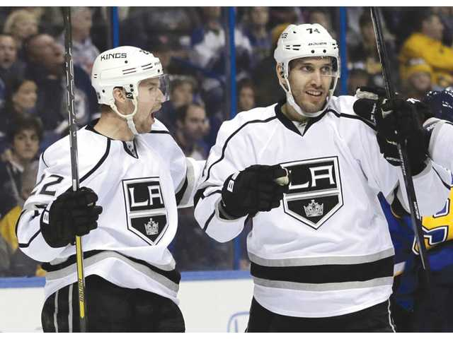 Los Angeles Kings players Trevor Lewis, left, and Dwight King celebrate after Lewis' goal against the St. Louis Blues on Thursday in St. Louis.