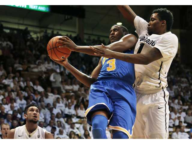 UCLA's Jordan Adams (3) prepares to shoot as Colorado's Wesley Gordon, right, defends in Boulder, Colo. on Thursday.