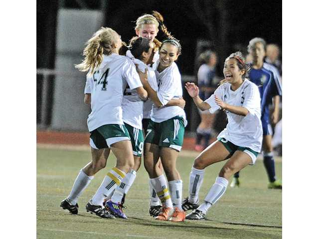 Canyon High girls soccer team members celebrate after Vanessa Quintero, second from left, scored the winning goal on Friday at Canyon High School.