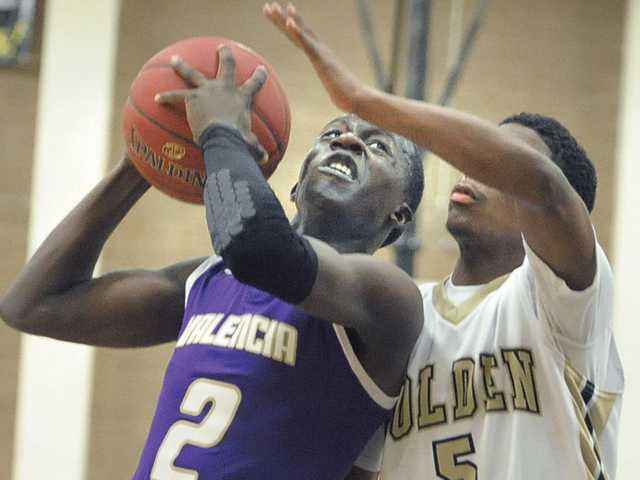 Valencia's Jaleel Howard (2) shoots against Golden Valley defender Cameron Knox (5) at Golden Valley High on Friday.